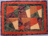 Pilgrim, Karen.  A fall themed quilted table mat made by Karen Pilgrim, Main Brook.