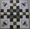 Pilgrim, Karen.  A flower basket quilted table topper made by Karen Pilgrim, Main Brook.