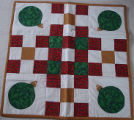 Pilgrim, Karen.  A Christmas themed quilted table topper made by Karen Pilgrim, Main Brook.