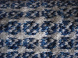 Carroll, Gertrude.  Close-up of traditional double-knit blue and white socks made by Gert Carroll,...