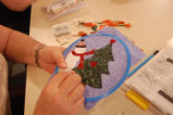 Main Brook Quilting Circle.  Alice Pilgrim works on a snowman themed quilting project, Main Brook.