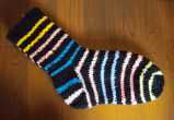 Fillier, Rita.  A pair of striped socks made by Rita Fillier, Main Brook.