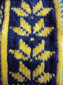 Fillier, Rita.  Close up a pair of traditional half-snowflake pattern mittens made by Rita...