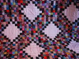 Patey, Gwen.  A small square patchwork quilt made by Gwen Patey, Quirpon.