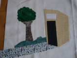 Patey, Gwen.  Work-in-progress outhouse panel for an applique Newfoundland quilt made by Gwen...