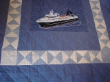 Patey, Gwen.  An applique boat quilt made by Gwen Patey for her husband, Quirpon.