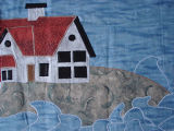 Patey, Gwen.  Close-up of an applique lighthouse wall hanging made by Gwen Patey, Quirpon.