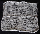 Tucker, Irene.  A 'Happy Holiday' doily made by Irene Tucker, Quirpon.