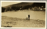 Two unidentified men standing near the Grand River