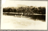 Two unidentified men fishing on the Grand River