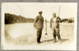Foote and his guide with a large salmon