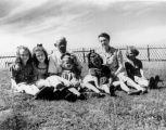 Dr. C.A. Forbes and his wife Irene (Matthews) Forbes, with children on the grounds on the...