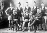 Reverend Jack Bartlett with a basketball team, including his two sons (marked by x)