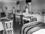 Nurse's aids, Joan March (left) and Aggie Cramm with patients on the women's ward, Bonavista...