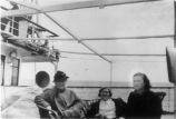 Kathleen (Forbes) Deir (right) and two unidentified women aboard a vessel en route to Newfoundland...