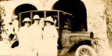 Evelyn (Smith) Armstrong, E.G. Smith, E.G. Smith's wife, standing in front of a car in India with...