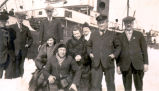 S.S. Viking Disaster: Seven men and two women standing near the S.S. ''Sagona.''