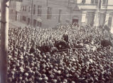 Alfred B. Morine, standing in a horse-drawn carriage, addressing a large crowd of striking sealers.