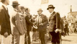 Field Marshall Haig with Rev. Nangle at his left, shaking hands with a man in a receiving line.