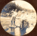 Three men fishing at South East River, near Placentia.