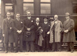 William Carson Job (fourth from right) and Robert Brown Job (second from right) standing with six...
