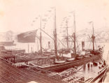 Vessels docked at Job Brothers & Co. north side premises, St. John's Harbour, with their flags flying