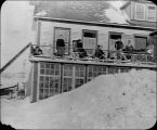 Patients on the veranda of the hospital at St. Anthony during the winter