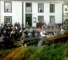''Prayer Meeting, Dr. Grenfell Leading, Battle Harbour, Labrador.''