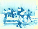 Inuit with sled