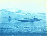 Inuit with kayaks