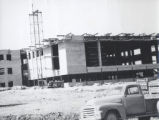 1.02.180: Construction of the Henrietta Harvey Building (library)