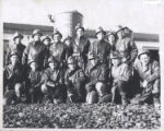 1.01.499: Engineering students waiting to go underground at Bell Island mines as part of their...