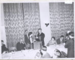 1.01.520: President Gushue presents a cup to Shirley Earle at the Athletic Union Banquet