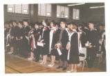 1.02.384: Graduates stand for the closing of convocation
